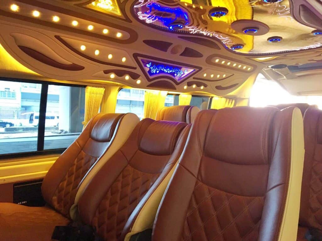 The inside of a 12Go Vip Van
